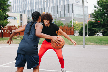 young woman plays basketball