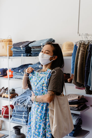 young woman shopping with face mask on