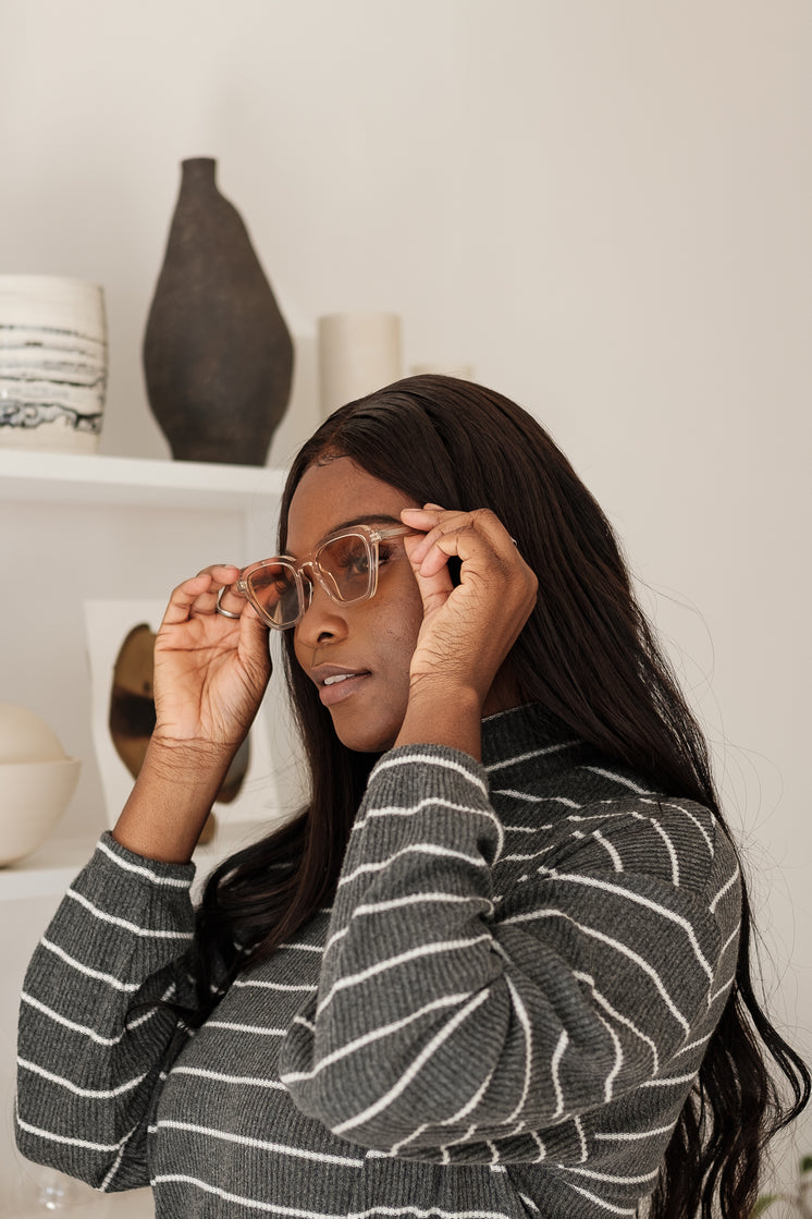 Young Woman Tries On Pair Of Sunglasses