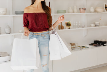 young woman with white shopping bags
